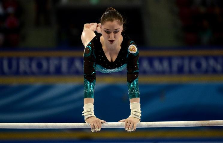 Алия Мустафина завоевала серебро на брусьях и бронзу на бревне